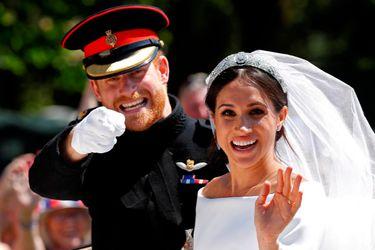 El príncipe Harry junto a su esposa Meghan Markle, después de su boda en la Capilla de San Jorge en el Castillo de Windsor, el 19 de mayo de 2018.