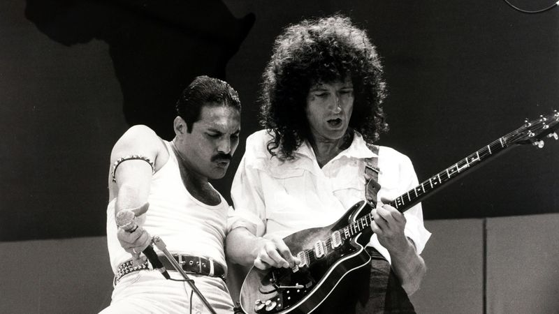 """Entertainment/Music. Live Aid Concert. Wembley, London, England. 13th July 1985. British singer Freddie Mercury with guitarist Brian May as """"Queen"""" perform at the charity concert."""