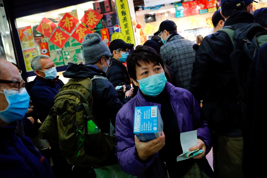 Customers queue to buy facial masks to prevent a new coronavirus outbreak in Hong Kong