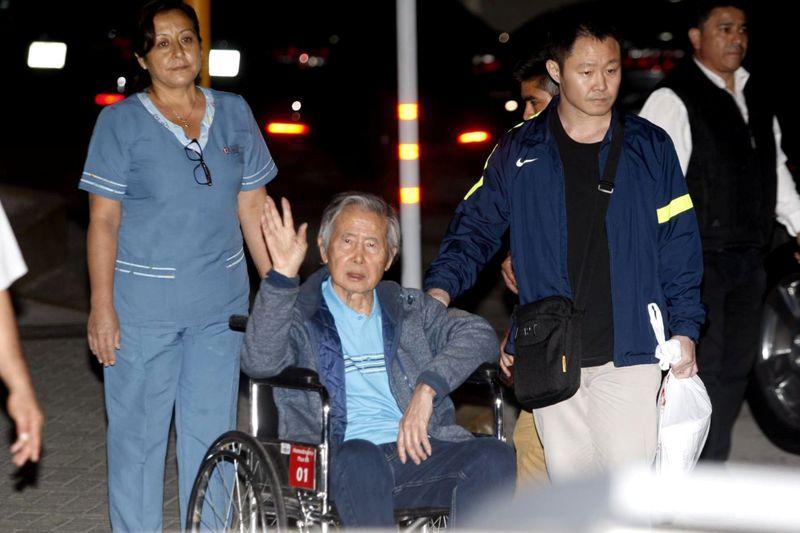 FILE PHOTO: Former Peruvian President Alberto Fujimori accompanied by his son Kenji Fujimori leaves hospital Centenario in Lima