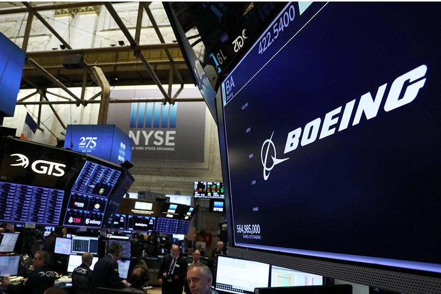 The company logo for Boeing is displayed on a screen on the floor of the NYSE in New York