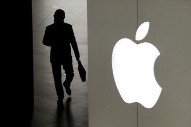 A man leaves an Apple store in Beijing, Thursday, Jan.