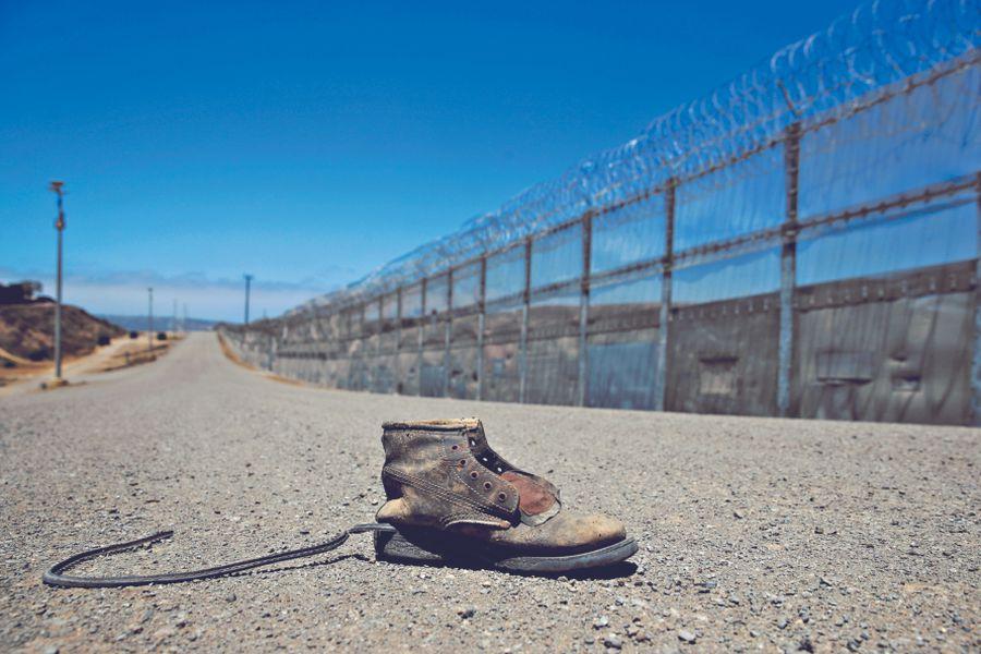 A shoe is left along a road in the enforcem (42276839)