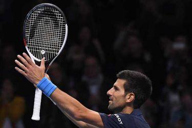 Serbia's Novak Djokovic celebrates winning his semi final match against Japan's Kei Nishikori