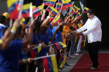 Venezuela's President Nicolas Maduro greets supporters as he arrives for an event with women at Miraflores Palace in Caracas