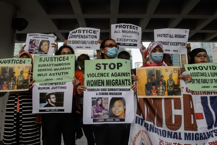Migrant workers protest in support of the victims of British banker R