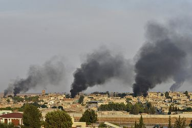 Smoke-rises-from-the-Syrian-border-town-of-Ras-al-Ain-as-it-is-pictured-from-the-Turkish-town-of-Ceylanpinar-in-Sanliurfa-province-(46976007)