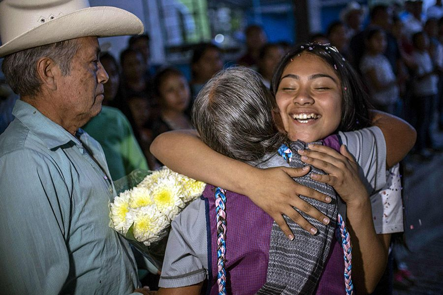 US-born Mexican Kelly Nape (R) embraces her grandmother during a fami
