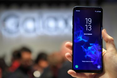 A woman holds a new Samsung Galaxy S9 mobilephone during the Samsung