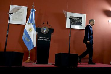 Argentina President Mauricio Macri leaves after a press conference at