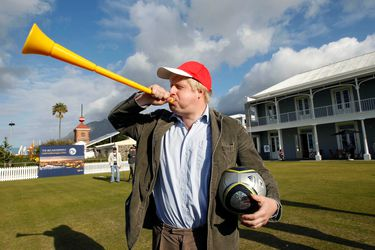 FILE PHOTO: London Mayor Boris Johnson blows a vuvuzela during his visit to Waterfront in Cape Town