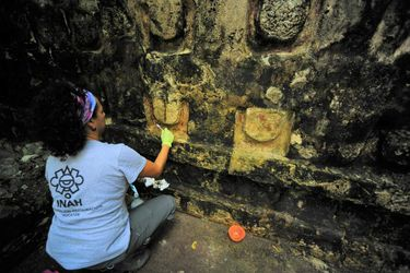 An archeologist works cleaning the stucco of the Temple of the U, located in the archaelogy area of Kuluba, in Tizimin