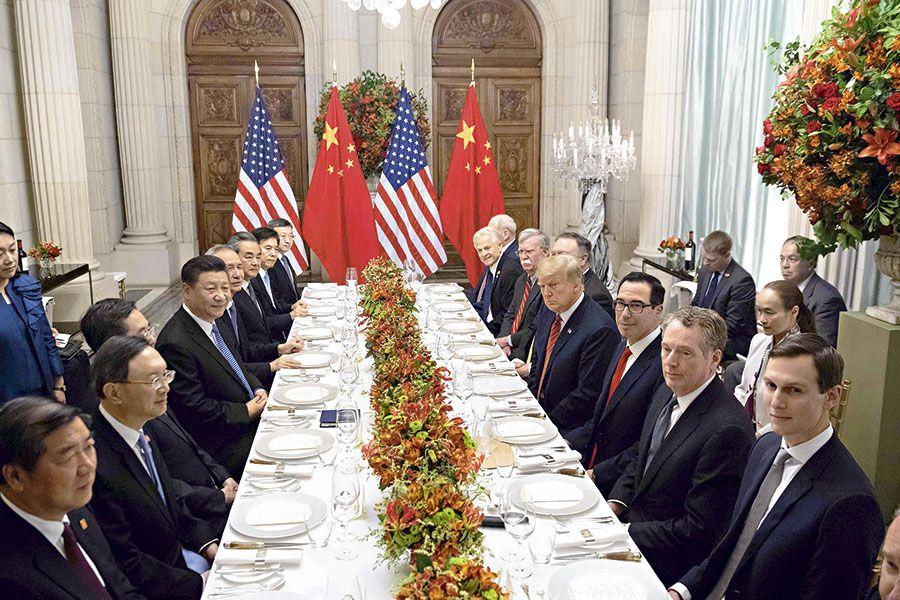 Donald Trump y su par chino, Xi Jinping  en la cumbre del G20.