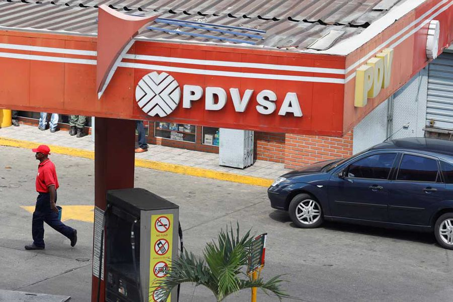 The corporate logo of the state oil company PDVSA is seen at a gas station in Caracas