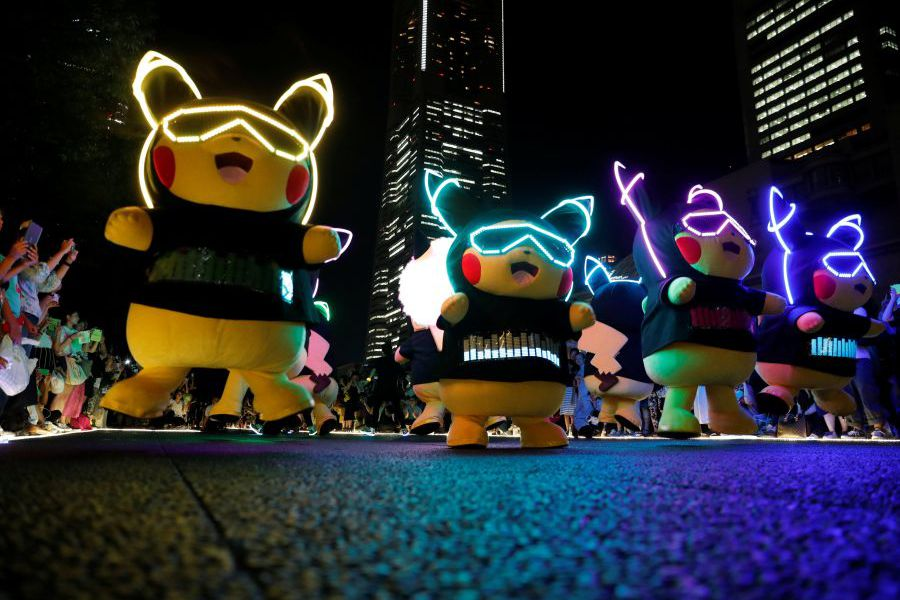 Performers wearing Pokemon's character Pikachu costumes take part in a night parade in Yokohama