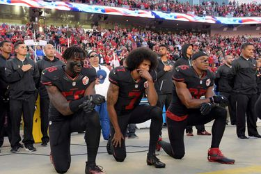 FILE PHOTO: San Francisco 49ers outside linebacker Harold, quarterback Kaepernick and free safety Reid kneel in protest in Santa Clara
