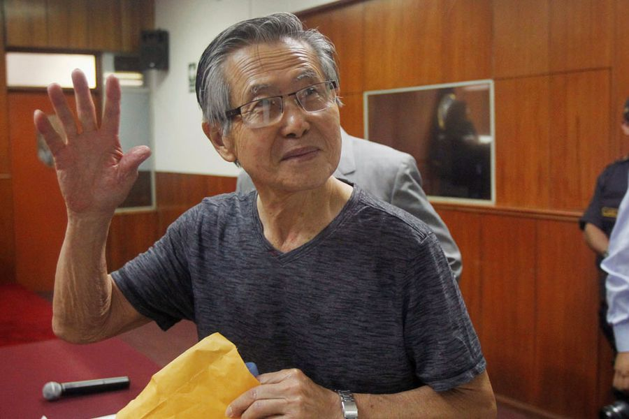 FILE PHOTO: Peru's former President Alberto Fujimori waves to the media as he arrives in court for the sentencing in his trial in Lima