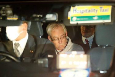 Greg Kelly, the former deputy of ousted Nissan chairman Carlos Ghosn, is seen in the car, as he leaves after being released from a detention centre in Tokyo