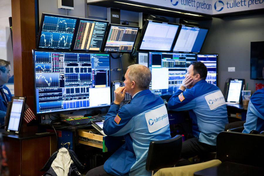Trading On The Floor Of The NYSE As Stocks Fluctuate