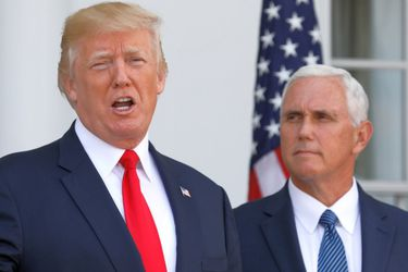 U.S. President Trump speaks to reporters with Vice President Mike Pence at his side in Bedminster, New Jersey