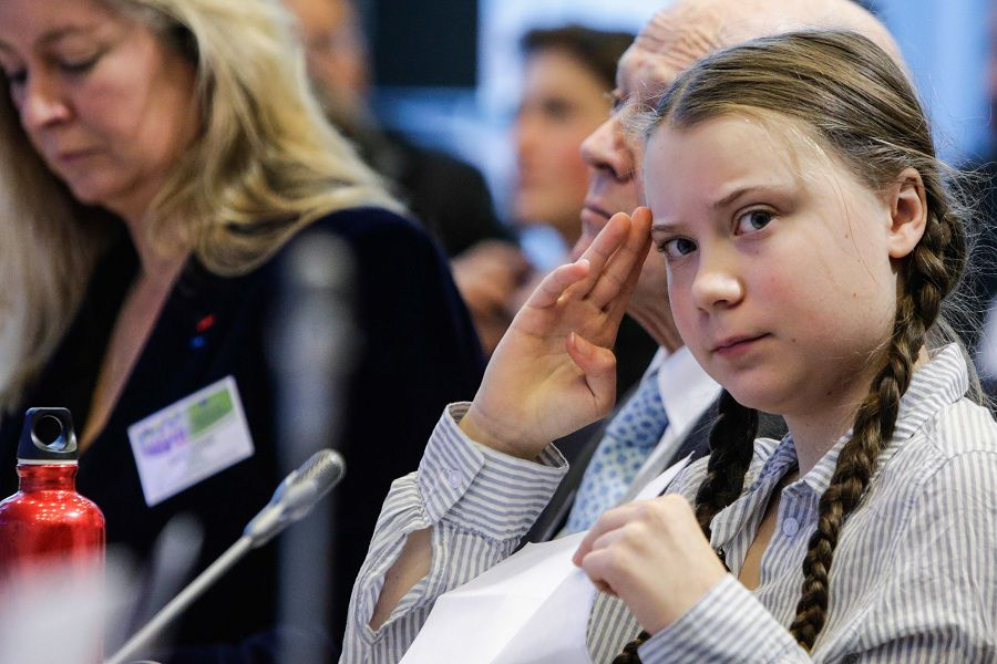 Swedish 16-years-old climate activist Greta Thunberg gestures as she