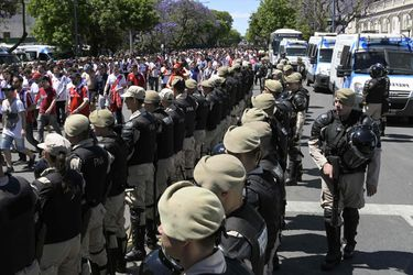 Security forces stand guard as River Plate's supporters leave the Mon