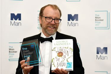 George Saunders, author of 'Lincoln in the Bardo', poses for photographers after winning the Man Booker Prize for Fiction 2017 in London