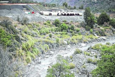 FILE PHOTO: Pipes of Alto Maipo hydroelectric project are seen next to Colorado river, in a pre-mountain range area on the outskirts of Santiago