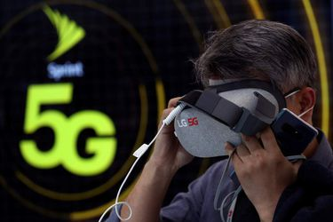 A man tests an LG 5G Virtual Reality device inside the LG booth at the Mobile World Congress in Barcelona