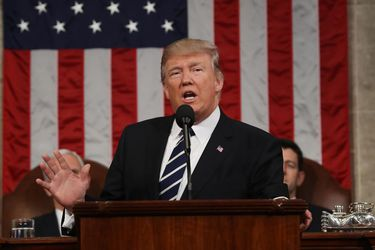 US President Donald J. Trump arrives to delivers his first address to a joint session of Congress from the floor of the House of Representatives in Washington
