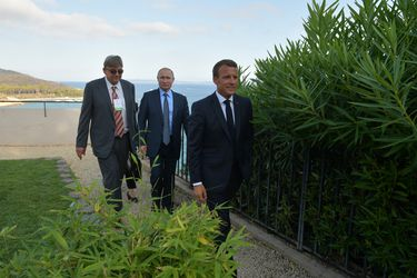Russian President Vladimir Putin meets with French President Emmanuel Macron near the village of Bormes-les-Mimosas