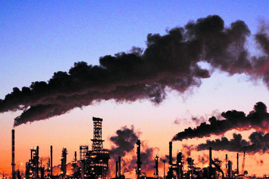 File photo of Petro-Canada's oil refinery glowing at dusk in Edmonton