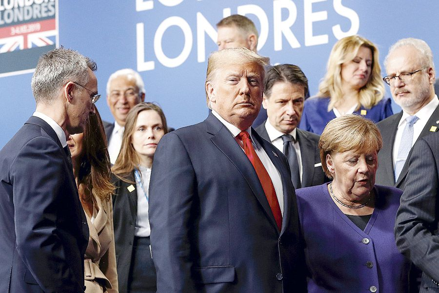 NATO-Alliance-leaders-leave-the-stage-after-family-photo-during-the-annual-NATO--heads-of-government-(47464318)
