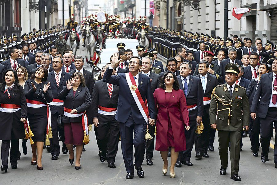 Peru's-President-Martin-Vizcarra-and-his-wife-and-first-lady-Maribel-Cabello-walk-together-after-Vizcarra--delivered-his-annual-address-in-Congress,-in-Lima-(46306694)