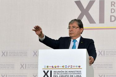 Colombia's Foreign Minister Carlos Holmes Trujillo offers a statement