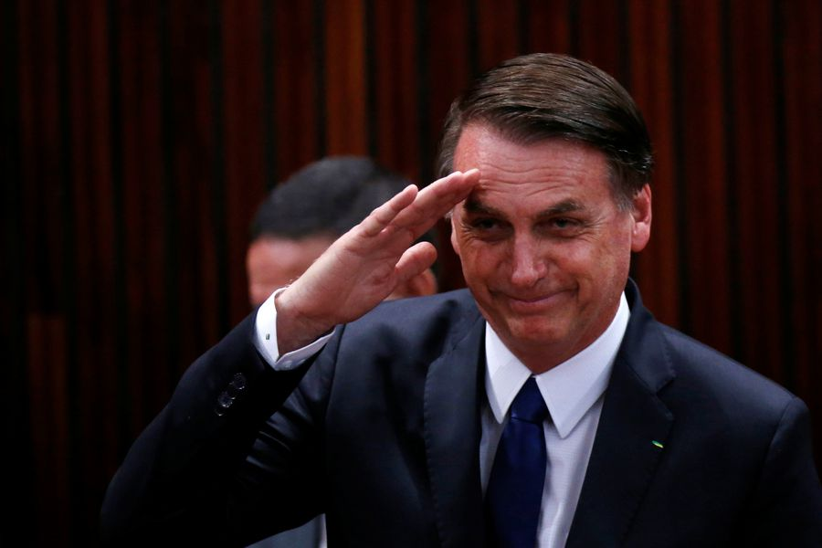 Brazil's President-elect Jair Bolsonaro salutes before receiving a confirmation of his victory in the recent presidential election in Brasilia