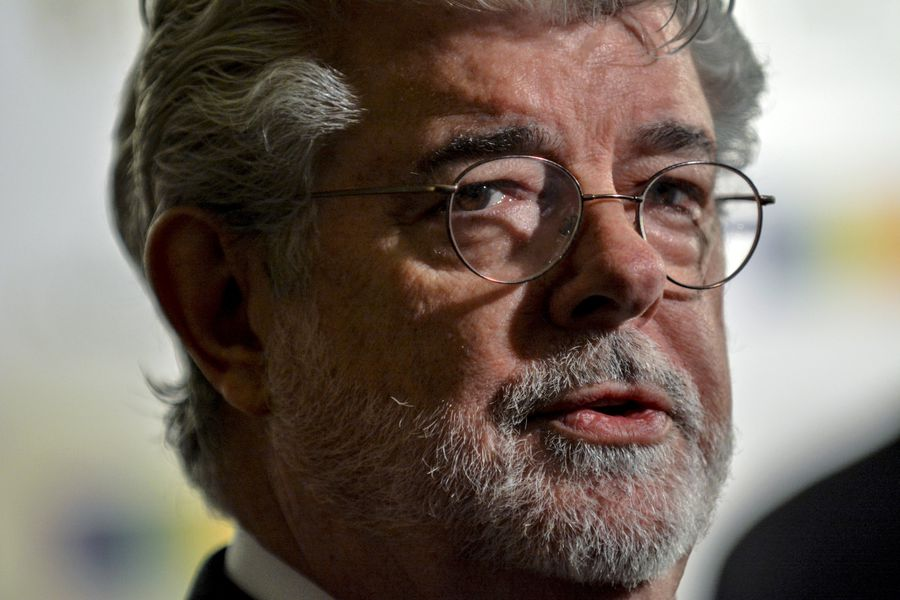 FILE PHOTO: George Lucas walks the red carpet before the Kennedy Center Honors at the Kennedy Center in Washington