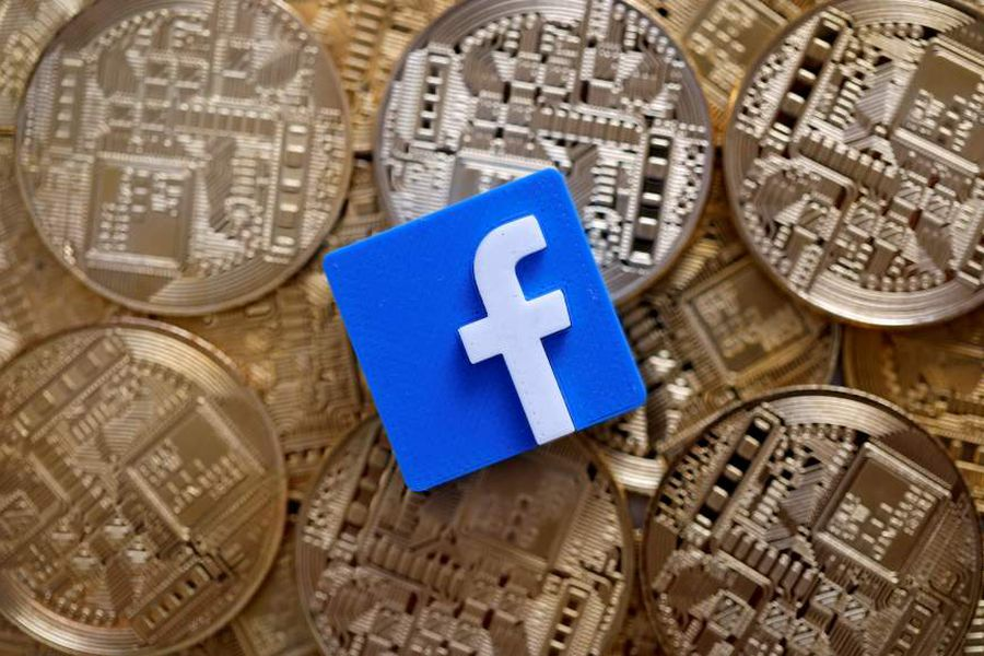 FILE PHOTO: Facebook logo is seen on representations of Bitcoin virtual currency in this illustration picture