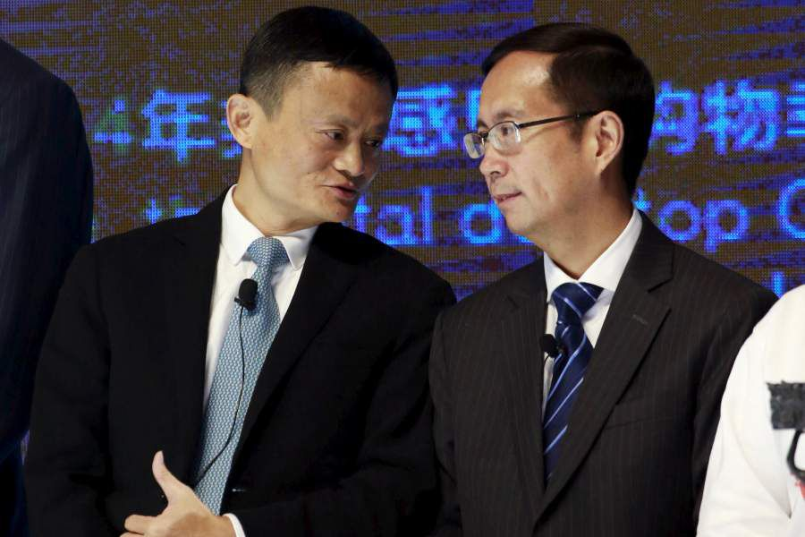 FILE PHOTO: Alibaba Founder and Chairman Jack Ma talks to CEO Daniel Zhang at NYSE Bell Ringing ceremony during Alibaba Group's 11.11 Global shopping festival in Beijing