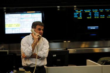 A trader works on the floor of Buenos Aires Stock  Exchange