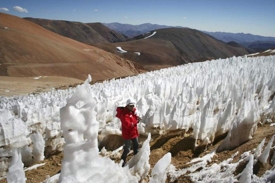 File picture of man walking by El Toro II glacier on the Chilean side of the border district between Chile's Huasco province and Argentina's San Juan province next to Pascua Lama gold project