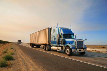 bigstock-Truck-on-freeway-12321044