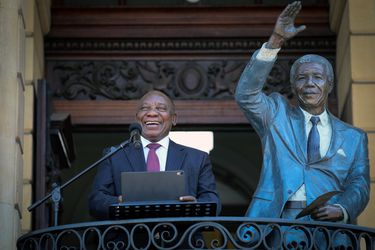 South Africa's President Cyril Ramaphosa speaks from the balcony where Nelson Mandela gave his first speech after his release from prison 30 years ago, in Cape Town