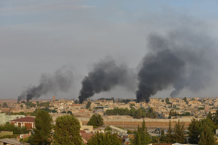 Smoke rises from the Syrian border town of Ras al-Ain as it is pictured from the Turkish town of Ceylanpinar in Sanliurfa province