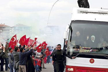 turkish-president-erdogan-is-greeted-by-his-37380079