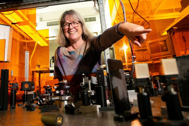 Donna Strickland, an associate professor at the University of Waterloo, is photographed in her lab following a news conference, after winning the Nobel Prize for Physics, at the university in Waterloo