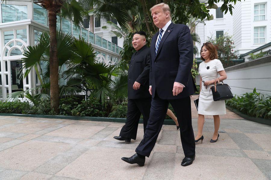 North Korea's leader Kim Jong Un and U.S. President Donald Trump walk at the Metropole hotel during the second North Korea-U.S. summit in Hanoi