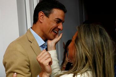 Spain's acting Prime Minister Pedro Sanchez is congratulated before a party meeting a day after Spain's general election, at PSOE headquarters in Madrid