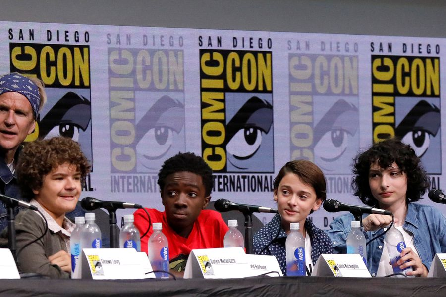 """Cast members Modine, Matarazzo, McLaughlin, Schnapp, Wolfhard and Brown at a panel for """"Stranger Things"""" during the 2017 Comic-Con International Convention in San Diego"""