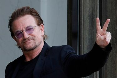 FILE PHOTO: Singer Bono of Irish band U2 and co-founder of ONE organization waves as he arrives at the Elysee Palace in Paris